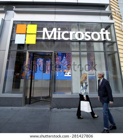 NEW YORK CITY - FRIDAY, MAY 8, 2015: Pedestrians walk past the corporate offices of Microsoft in Manhattan. Microsoft is an American technology company.   - stock photo
