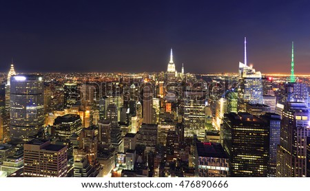 New York City illuminated skyline at night, USA