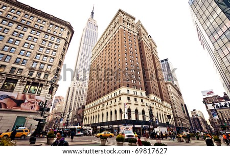 NEW YORK CITY - JAN 6: point of intersection of 34th st, 6th avenue and Broadway, with an Empire State Building on background. January 6, 2011 in Manhattan, New York City. - stock photo