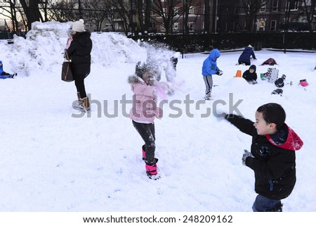 NEW YORK CITY - JANUARY 28 2015: Asphalt Green, a non-profit center on Manhattan's Upper East Side, sponsored its annual Snowman Showdown on the football fields of its 90th Street campus. - stock photo