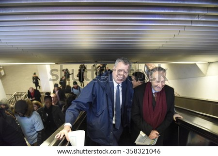 NEW YORK CITY - JANUARY 4 2015: Mayor de Blasio & senator Schumer greeted early morning commuters with information about benefits to lower the cost of mass transit. Mayor & senator ride escalator