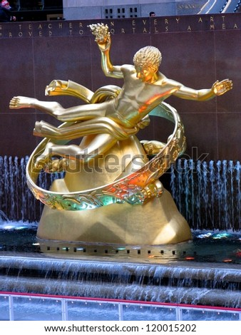 NEW YORK CITY - JANUARY 18: The golden Prometheus statue at the Rockefeller center on January 18, 2010 in New York, NY. This bronze gilded statue  is located at the front of 30 Rockefeller Plaza - stock photo