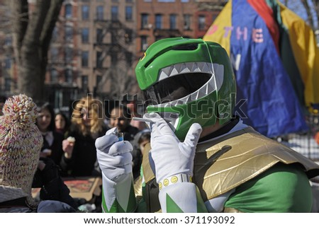 NEW YORK CITY - JANUARY 30 2016: the 12th annual Idiotard race began in Manhattan's LES & ended in Gowanus, Brooklyn. Member of team Power Rangers has smoke - stock photo