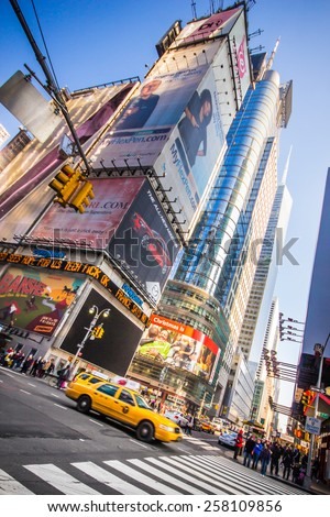 NEW YORK CITY - JANUARY 6, 2013:  View of intersection at landmark Times Square in midtown Manhattan as yellow taxicab passes by. - stock photo