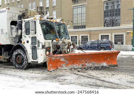 NEW YORK CITY - JANUARY 27, 2015. While snowfall was much less than originally forecasted, the streets of New York City were filled by trucks with plows removing snow all day after the storm.