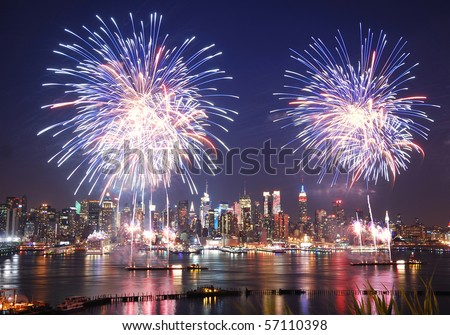 NEW YORK CITY - JUL 4: Manhattan Independence Day firework show in Hudson River as annual traditional event to celebrate the birth of United States, July 4, 2010 in Manhattan, New York City. - stock photo