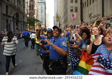 NEW YORK CITY - JULY 11 2015: a ticker tape parade was held for the champion US women's FIFA team along Canyon of Heroes on Broadway. NYPD community affairs officers during parade - stock photo