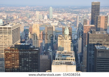 NEW YORK CITY - JULY 17: Aerial View of Manhattan. It is home to some of the city's most iconic buildings and it contains world-famous commercial zones.