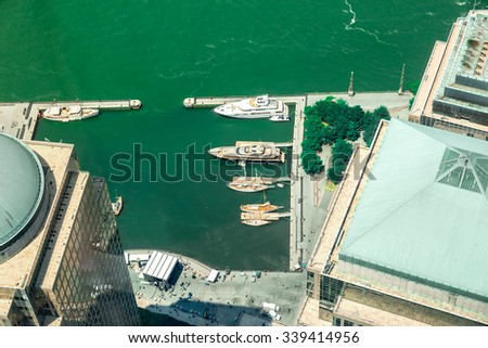 NEW YORK CITY - JULY 13: Aerial view on Brookfield Place on July 13, 2015 in New York. Brookfield Place is a complex of office buildings located across West Street from the WTC in Manhattan. - stock photo