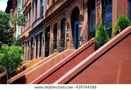 New York City - July 13, 2007:  Beautifully restored early 20th century brownstones with stoops on West 120th Street in Harlem