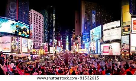 NEW YORK CITY - JULY 1: Panoramic shot of Times Square, featured with Broadway Theaters and animated LED signs, is a symbol of New York City, July 1, 2011 in Manhattan, New York City. - stock photo