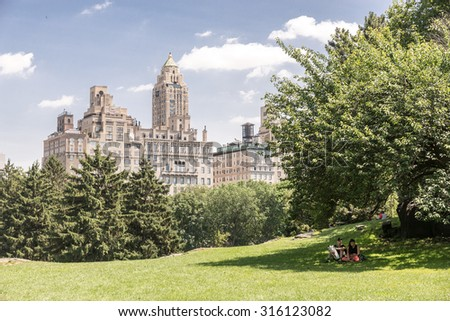 NEW YORK CITY - JULY 10: People have rest in Central Park on July 10, 2015 in New York. Central Park is an urban park in the central part of the borough of Manhattan.