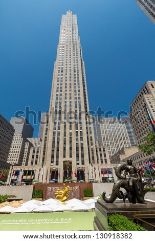 NEW YORK CITY - JULY 12: Prometheus Statue near Rockefeller Center on July 12, 2012 in New York. Rockefeller Center is a complex of 19 commercial buildings. It is a National Historic Landmark. - stock photo