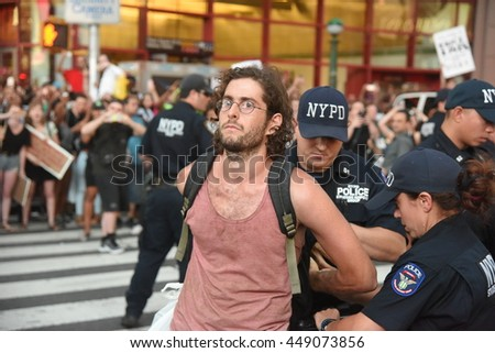 NEW YORK CITY - JULY 7 2016: Several thousand activists rallied & marched to protest recent police-involved shootings in Minnesota & Louisiana. Arrest for blocking 7th Avenue