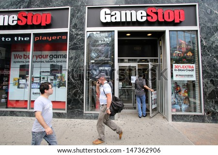 New york city july 8 shoppers stock photo 147362918 shutterstock new york city july 8 shoppers walk past a gamestop retail store in new sciox Choice Image