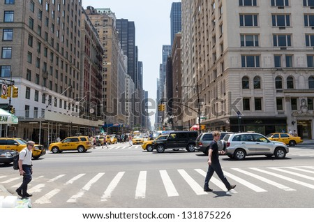 NEW YORK CITY - JULY 12: Sixth avenue traffic on July 12, 2012 in New York. Sixth avenue is a major thoroughfare in New York City's borough of Manhattan. - stock photo