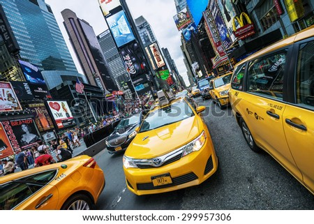 NEW YORK CITY - JULY 9: Taxi on Times Square, an iconic street of New York City and America, July 9, 2015 in Manhattan, New York City. Special photographic processing - stock photo