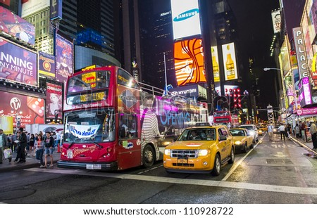 NEW YORK CITY - JULY 21: The Times Square at night on July 21, 2012 in New York, Times Square is major commercial intersection in New york and one of the most visited tourist attractions in the world. - stock photo