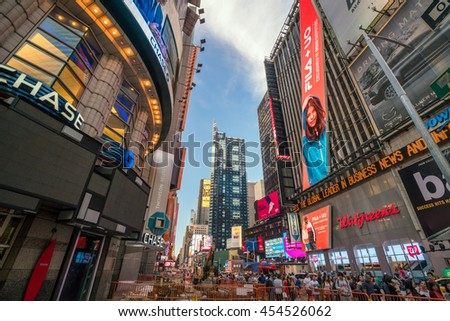 NEW YORK CITY -JULY 2: Times Square at night with animated LED signs on July 2, 2016 in Manhattan, New York City. USA. It is a symbol of New York City and the United States  - stock photo