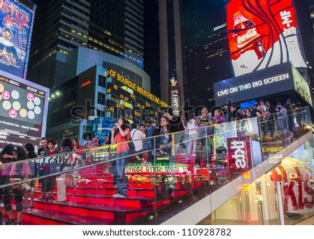 NEW YORK CITY - JULY 21 :Tourists in the Times Square on July 21,2012 in New York,Times Square is major commercial intersection in New york and one of the most visited tourist attractions in the world. - stock photo