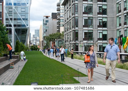 NEW YORK CITY - JUN 24: High Line Park in NYC on June 24, 2012. The High Line is a public park built on an historic freight rail line elevated above the streets on Manhattan'Â?Â?s West Side. - stock photo