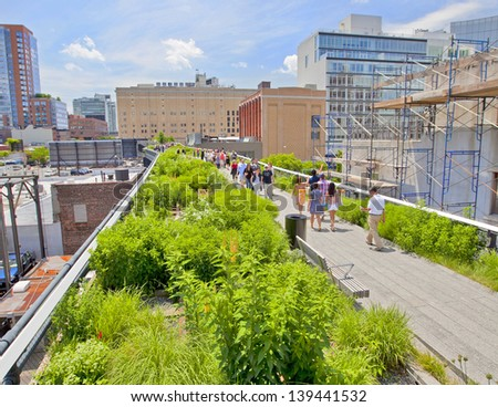 NEW YORK CITY - JUN 3: High Line Park in NYC seen on June 3rd, 2012.The High Line is a public park built on an historic freight rail line elevated above the streets on Manhattans West Side. - stock photo