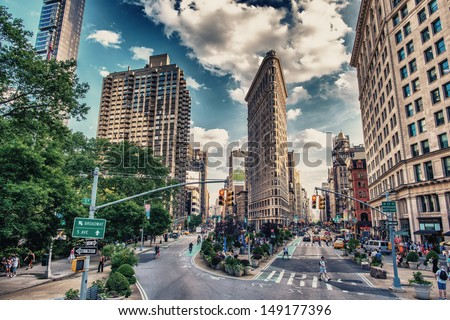 NEW YORK CITY - JUN 10: Historic Flatiron Building in NYC as seen on June 10, 2013. This iconic triangular building located in Manhattan's Fifth Ave was completed in 1902 - stock photo