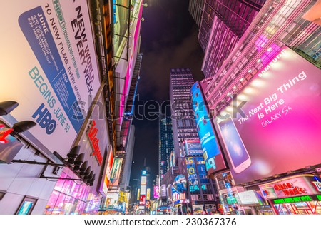NEW YORK CITY - JUN 8: Nighttime lights in Times Square, with pedestrian's crowds and traffic on June 8, 2013 in New York, NY, USA - stock photo