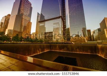NEW YORK CITY - JUN 12: NYC's 9/11 Memorial at World Trade Center Ground Zero seen on June 12, 2013. The memorial was dedicated on the 10th anniversary of the Sept. 11, 2001 attacks - stock photo