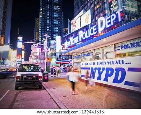 NEW YORK CITY - JUN 3: NYPD office in Times Square on June 3rd, 2012. Times Square is a busy tourist intersection of neon art and commerce and is an iconic street of New York City - stock photo