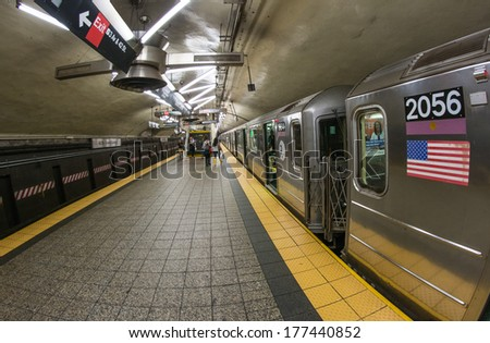 NEW YORK CITY - JUN 12, 2013: People inside a Manhattan subway station. The New York City Subway is also one of the world's oldest public transit systems - stock photo