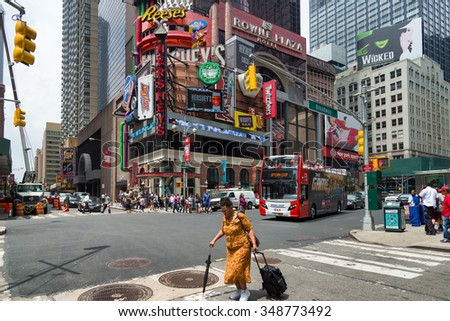 NEW YORK CITY - JUNE 15, 2015: Busy intersection of Broadway and 48th St. Broadway is best known as the road in New York home of many theatres and shows.