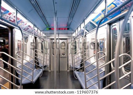 NEW YORK CITY - JUNE 27: Empty subway wagon on June 27, 2012 in NYC. The NYC Subway is one of the oldest and most extensive public transportation systems in the world, with 468 stations. - stock photo