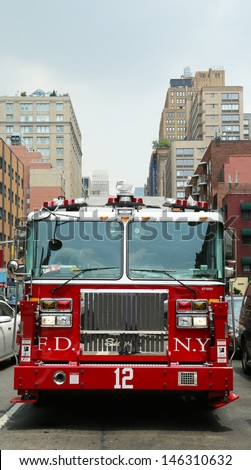 NEW YORK CITY - JUNE 27: FDNY Tower Ladder 12 truck in Manhattan on June 27, 2013.  FDNY is the largest combined Fire and EMS provider in the world - stock photo