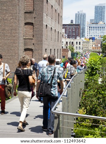 NEW YORK CITY - JUNE 3: High Line Park in NYC seen on June 3rd, 2012.The High Line is a public park built on an historic freight rail line elevated above the streets on Manhattans West Side. - stock photo