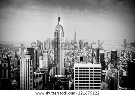 NEW YORK CITY - JUNE 17, 2014: Lower Manhattan skyline in B&W. Manhattan has been described as the economic and cultural center of the United States. - stock photo