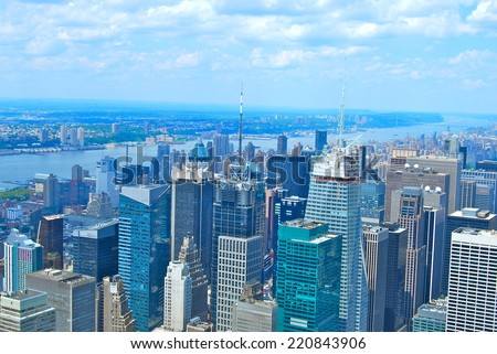 NEW YORK CITY - JUNE 25, 2008: New York City Manhattan midtown view with skyscrapers and blue sky in the day, New York City, USA. - stock photo