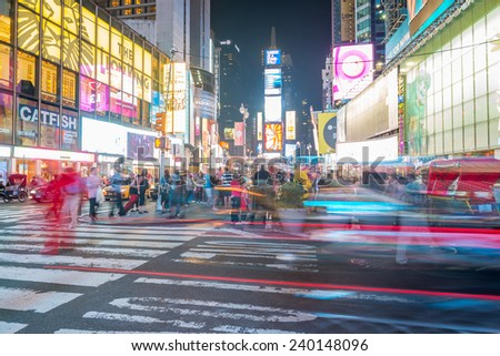 NEW YORK CITY - JUNE 12, 2013: Night view of Times Square lights. Times Square is a busy tourist intersection of neon art and commerce and is an iconic street of New York City. - stock photo