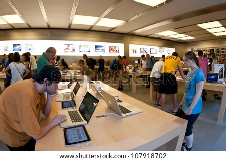 NEW YORK CITY - JUNE 23: People visiting the Apple Store on 5th Avenue June 23, 2012 in NY. As of June 2012, Apple has 363 stores worldwide, with global sales of US$16 billion in merchandise in 2011. - stock photo