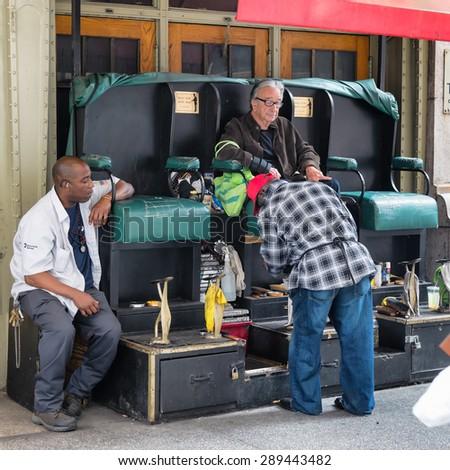 NEW YORK CITY - JUNE 17, 2015: Shoeshiner working in the center of New York - stock photo