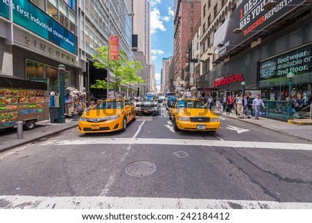 NEW YORK CITY - JUNE 12, 2013: Taxi cab in city street. The are more than 13,000 taxis in the city.