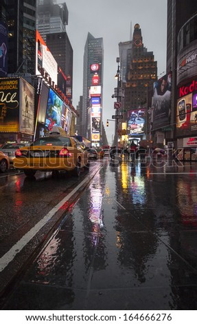 NEW YORK CITY - JUNE 7th: A wet Times Square june 7th, 2013 in New York, NYC, USA.  - stock photo