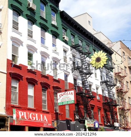 New York City - June 28th, 2014: Little Italy neighborhood in NYC, NY on June 28th, 2014. This Italian neighborhood in lower Manhattan is known for its restaurants, shops and the feast of San gennaro. - stock photo
