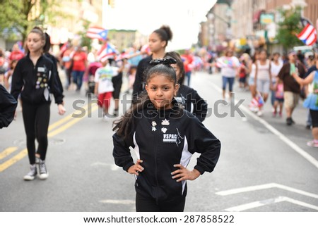 NEW YORK CITY - JUNE 14 2015: the first Sunset Park Puerto Rico Day parade in three decades was held along 5th Avenue in Brooklyn late in the evening to permit attendance at the Manhattan parade