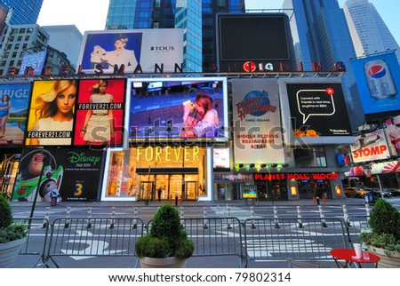 NEW YORK CITY - JUNE 27, 2010: The landmark Bertelsmann Building in Times Square is home to the flagship stores of Planet Hollywood and Forever 21 among others June 27, 2010 in New York, NY. - stock photo