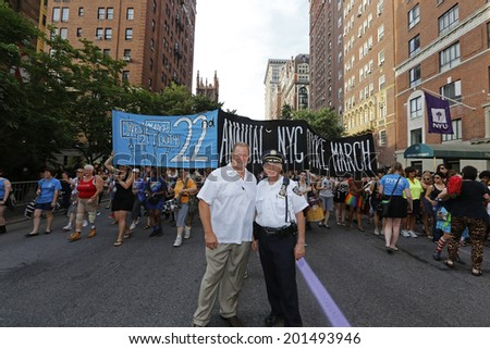NEW YORK CITY - JUNE 28 2014: the 22nd Annual NYC Dykes March brought thousands onto Fifth Avenue & stretched from Bryant Park to Washington Square Park. NYPD Sergeant Smarsch (lt) & Dep Chief Anger