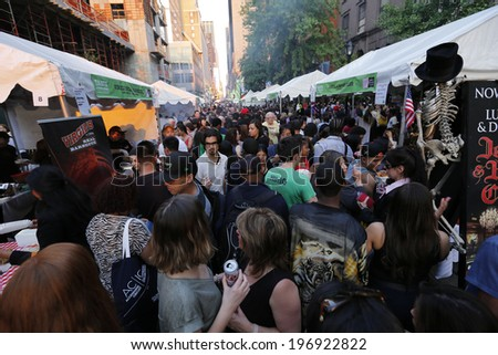 NEW YORK CITY - JUNE 2 2014: the Times Square Alliance sponsored its annual Taste of Times Square, featuring 40 plus area restaurants that offered attendees small plate samples of their signature fare