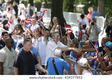 NEW YORK CITY - JUNE 12 2016: thousands filled the streets of Manhattan & Brooklyn to celebrate NYC's 59th annual Puerto Rico Day. NYC mayor Bill de Blasio marches in parade