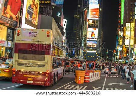 NEW YORK CITY - JUNE 18 2016: Times Square crowds at night in Midtown Manhattan. The site is regarded as the world's most visited tourist attraction with nearly 40 million visitors annually.