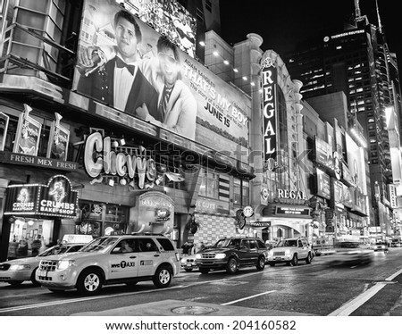 NEW YORK CITY - JUNE 3, 2012: Times Square in black and white, famous tourist attraction featured with Broadway Theaters and famous restaurant and store locations in New York City - stock photo